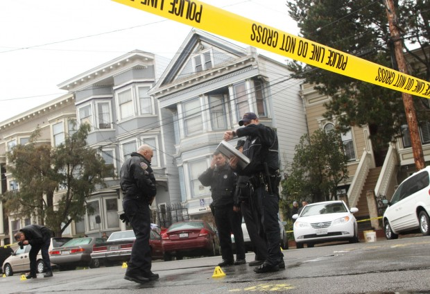 Police examine the scene after a gunfight on Harrison and 24th