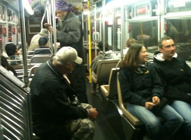 A passenger harasses a couple inside bus 14