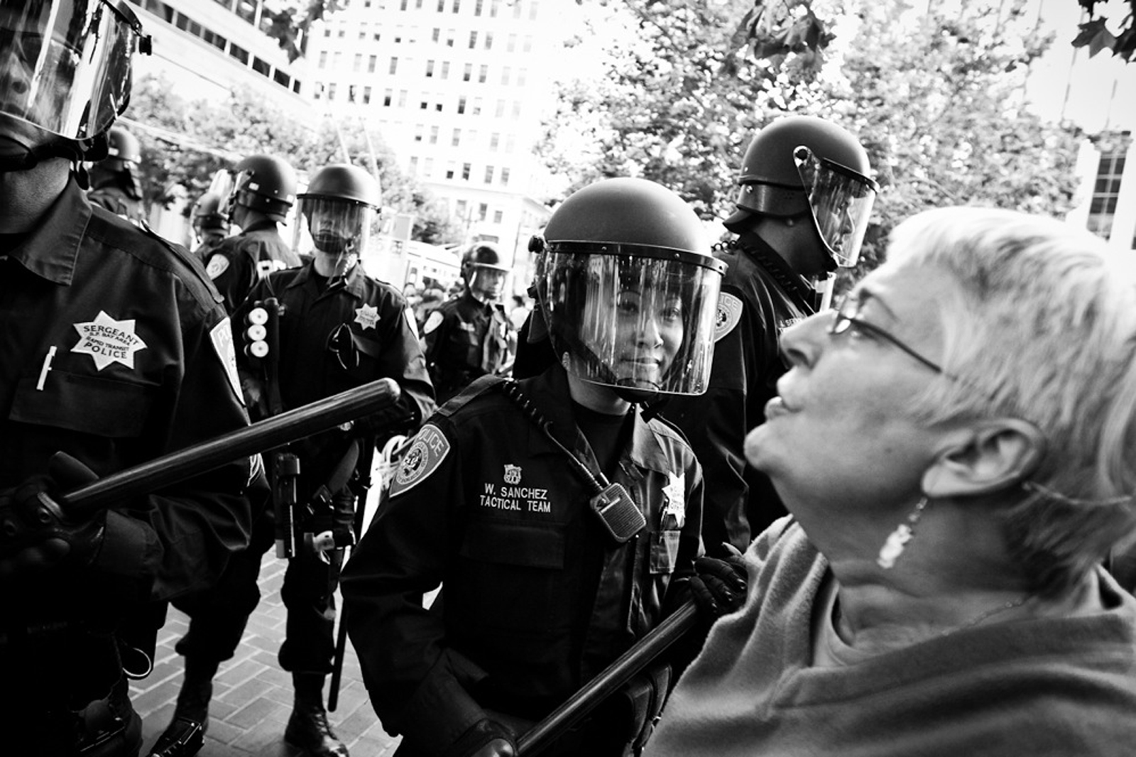 A protester shouts at BART police during a demonstration outside the Civic Center BART station, August 15, 2011.