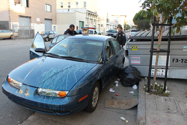 A suspected drunk driver crashed into a dumpster Wednesday evening, injuring a pedestrian and covering his car with debris and paint. Photo by Ryan Loughlin