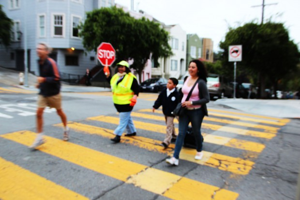 A crossing guard outside of St. James Elementary.
