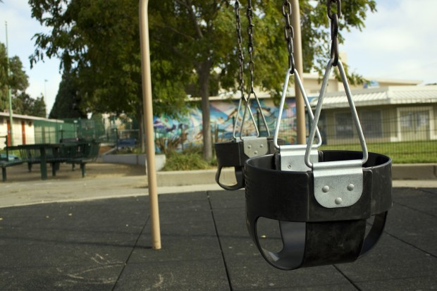 Empty swings at Garfield Park. Photo by Justine Quart