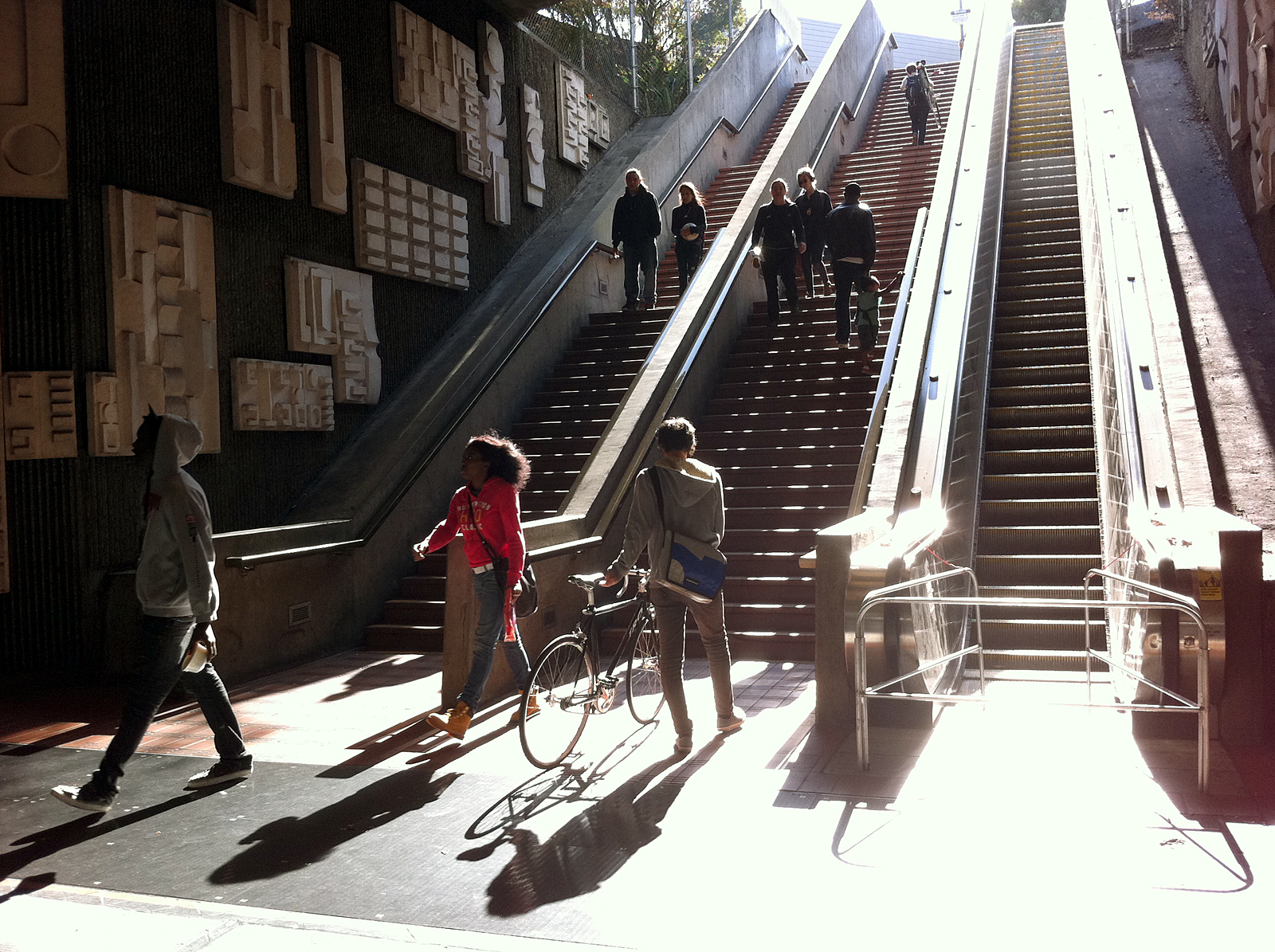 The disabled southwest escalator at 24th Street Mission BART forces passengers to use the stairs to reach the plaza.
