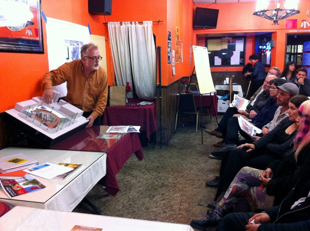 BART principal planner Rube Warren demonstrates the planned changes for the southwest 24th Street Mission plaza on a miniature mockup.