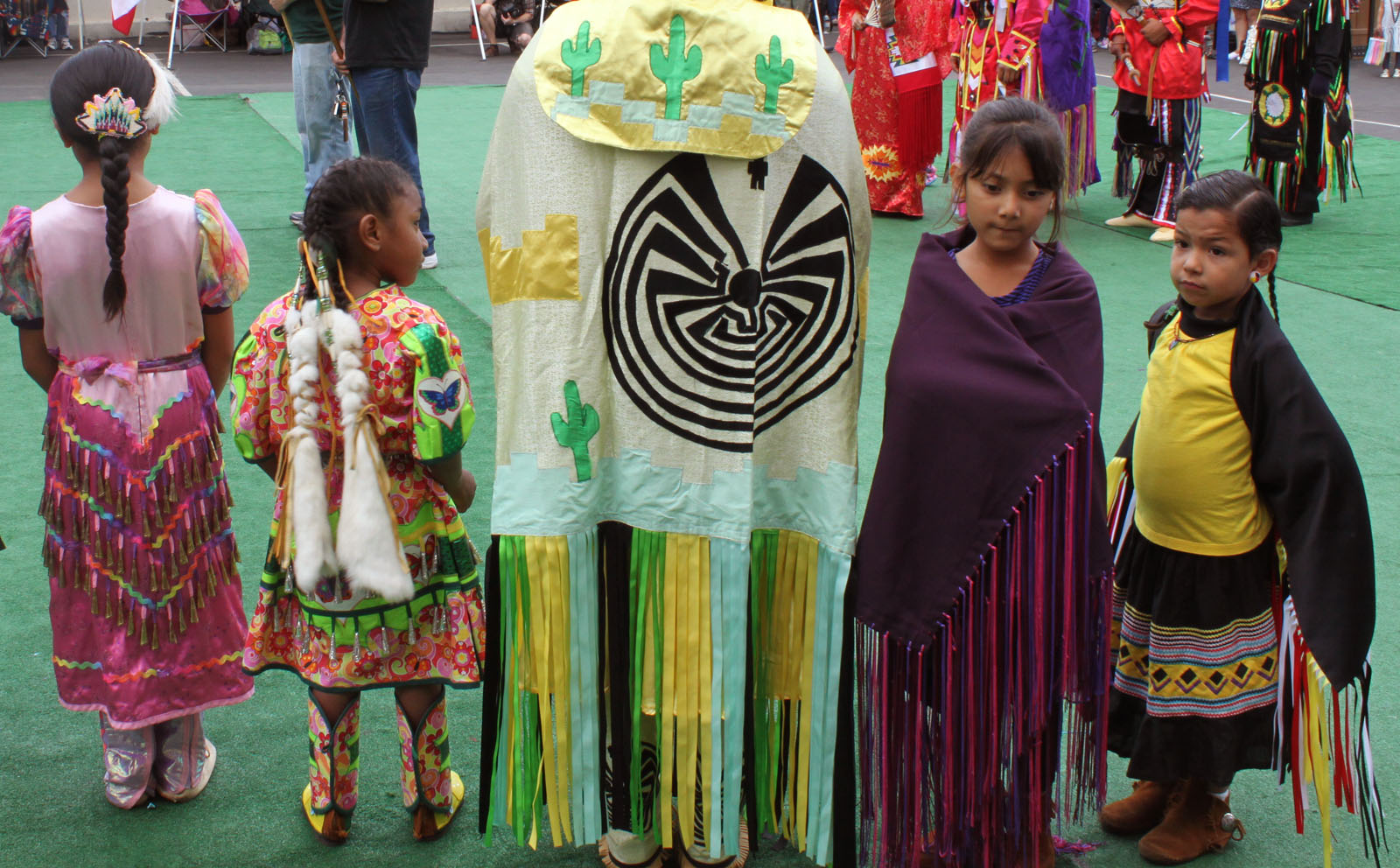 American Indian youth get ready for the Dancing Feathers powwow earlier this month. Many urban Native youth struggle for recognition in their own city.