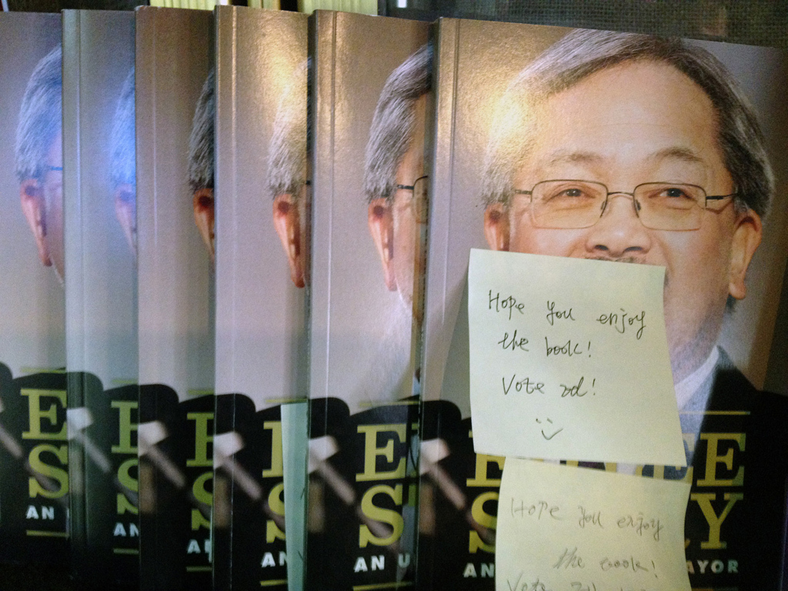 "At Philz Coffee the flier table has 16 free copies of Lee's ""book"" with handwritten post-its beseeching customers to vote Ed. Photo taken by Matt Sarnecki. (2011)"