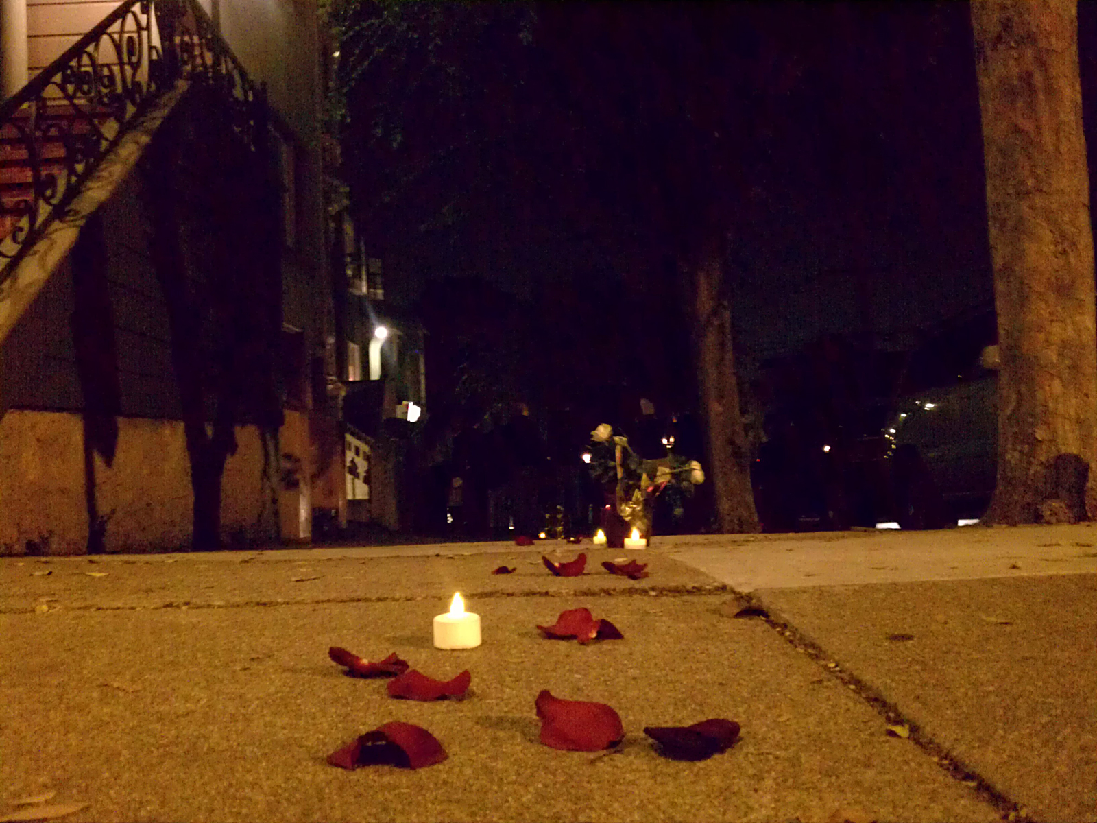 Neighbors scattered rose petals and candles during a vigil on Dec. 14. Photo by Hélène Goupil