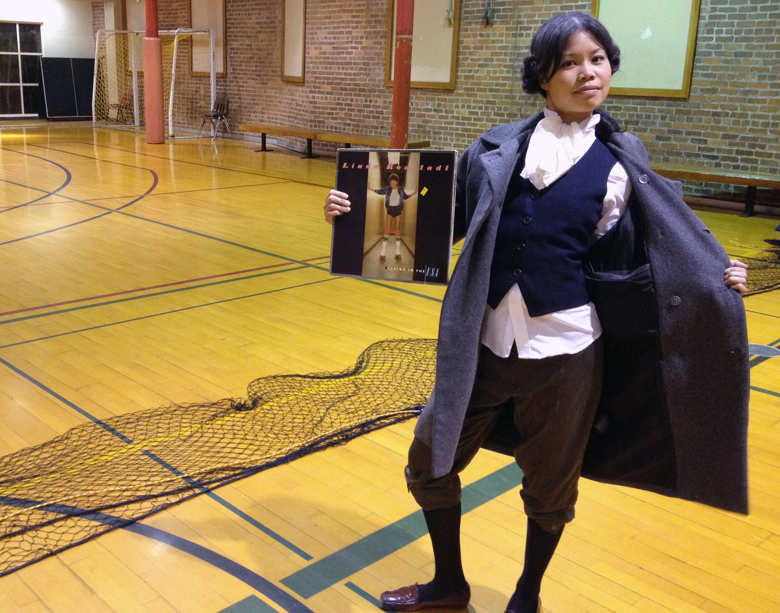 Grace, dressed as a young John Adams, wins the costume contest at open gym dodgeball at the Mission Recreation Center Monday night.