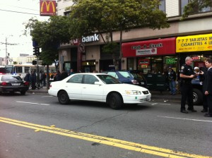 Police question witnesses at 16th and Mission streets.