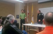 Gregory Dicum presents a petition to increase police patrols on Capp Street to fight upsurge in prostitution.