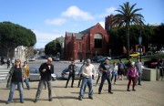 Donald Saldana (in white) teaches a basic salsa step on a makeshift dance floor in Dolores Park.