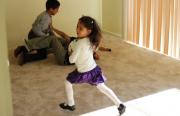 Hernandez's kids play in an empty apartment on Treasure Island.