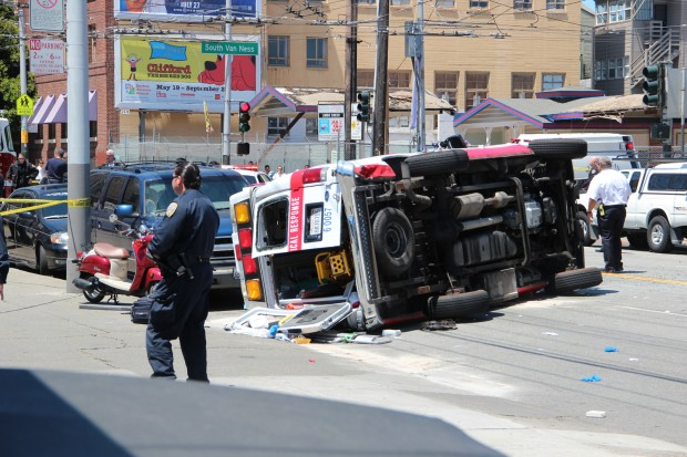 The ambulance was carrying three passengers, police said. Photo by Ross Torres.