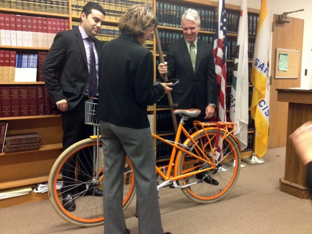 Leah Shahum, the executive director of the San Francisco Bicycle Coalition, demonstrates how to properly lock a bicycle