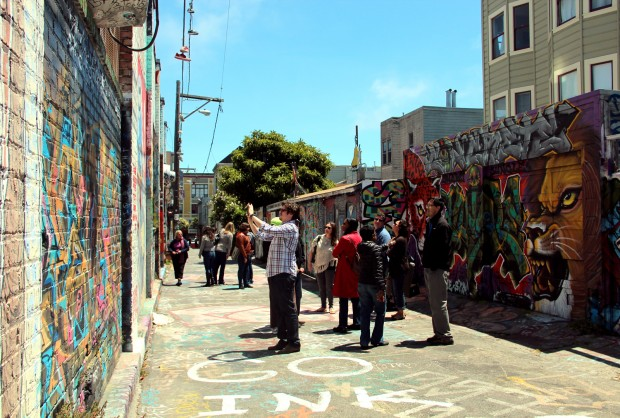 A tourist group browses Clarion Alley.
