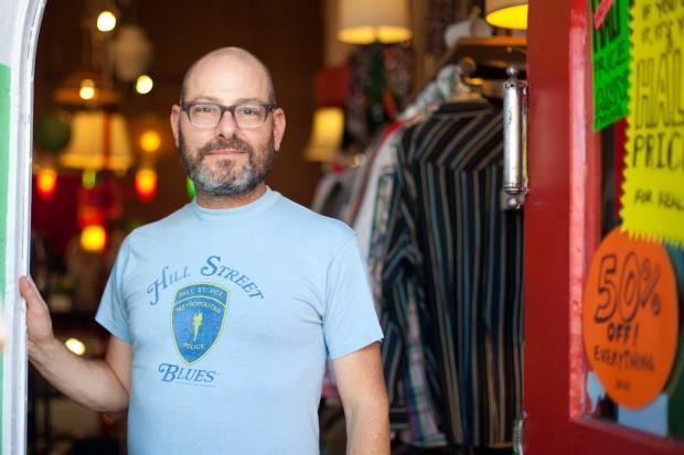 David Marks standing in the doorway of his shop, Room 4.