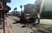 Construction crews repave Mission Street in phases on the corner of 17th Street.