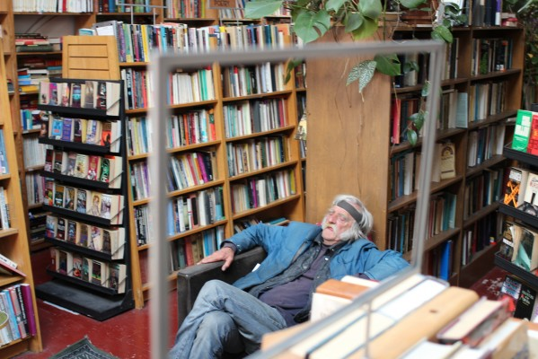 A regular at Adobe Books relaxes in the afternoon. Adobe has cultivated a strong community vibe since opening in 1989.