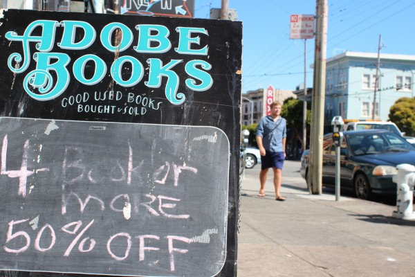Outside Adobe Books a sign lets customers know that prices are being lowered.