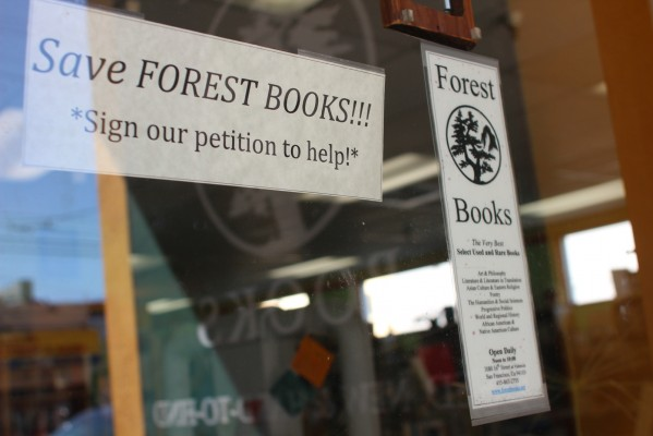 A sign on the door at Forest Books urges patrons to sign a petition to save the store. After nearly a quarter-century on 16th St. near Valencia, the store's rent has gone up by 300 percent.