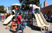 Volunteers from Zynga and KaBOOM! team up to build a new playground at the Mission YMCA over the weekend. Photo by Chelsi Moy