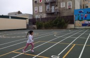 A little girl runs across the newly refurbished playground area at Marshall Elementary School.