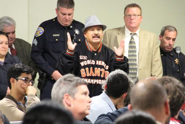 Roberto Hernandez addresses the crowd at the Good Samaritan Family Resource Center Monday night.