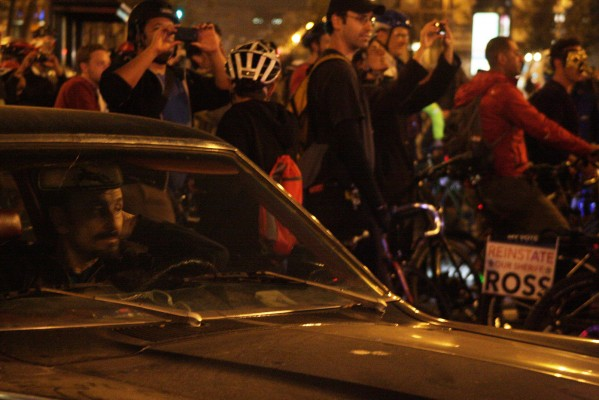 A frustrated driver waits for cyclists to move from an intersection near United Nation's Plaza. Photo by Rigoberto Hernandez.