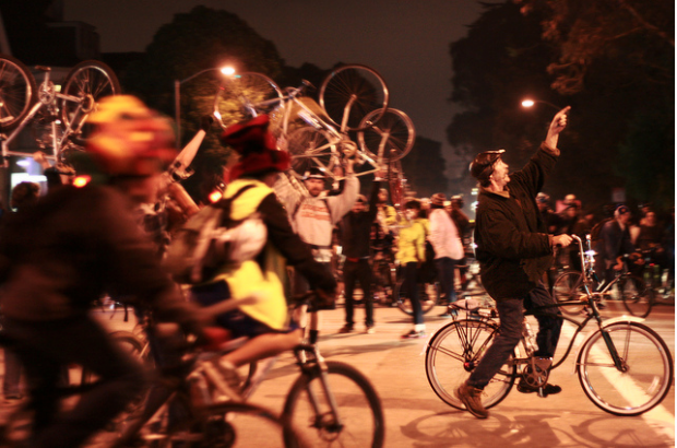 Bikers pedal through the night for Critical Mass.