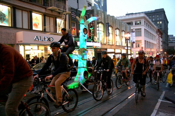 Thousands of Critical Mass supporters head north on Powell St. Photo by Talal Ansari.