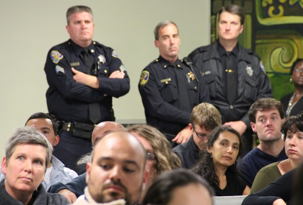 Community members listen to the panel at the the Good Samaritan Family Resource Center Monday night.