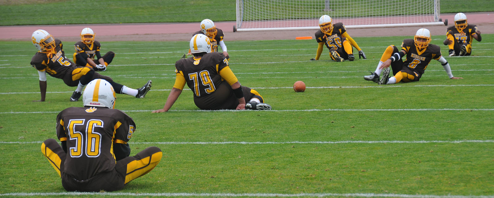 Mission High varsity football players stretch before game. Photo by: Alejandro B. Rosas