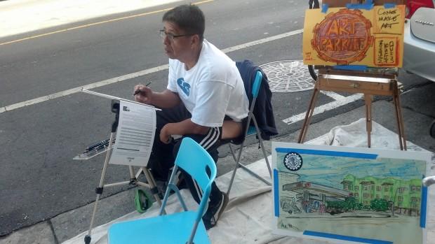 Mission artist Alejandro Leyva stopped at the pop-up art parklet to sketch a street scene.