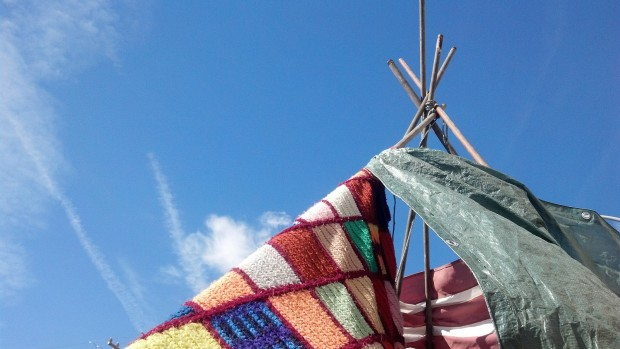 A colorful teepee made of metal pipes and colorful blankets stood in the parking spot in front of Serendipity.