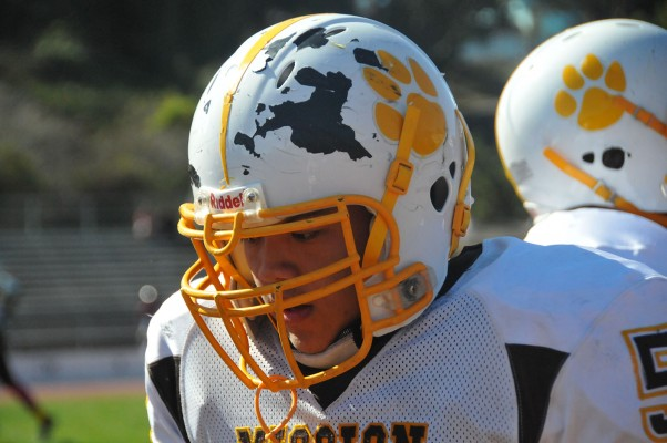 The paint came off a football player's helmet after contact on the field.