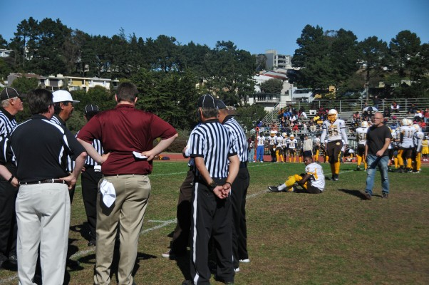Referees, coaches, and school officials decided if the game should continue after the fight.
