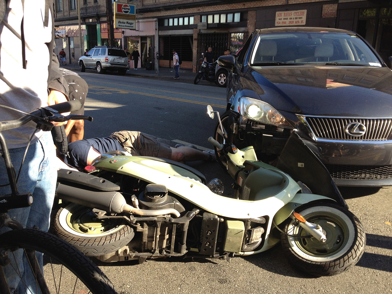 Scooter and Car Collide on 16th Street