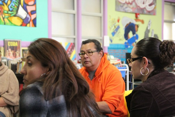 Community Response Network member Ray Balberan listens during the Mission Peace Collaboration meeting.