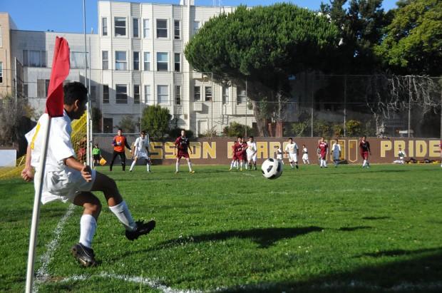 Cristian Cortes kicks a corner kick in the first half. Cortes plays half back against ISA