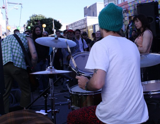 A band plays to a growing crowd.