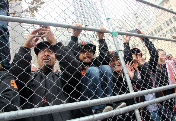 Fans watch the Giants parade. Photo by Chelsi Moy.