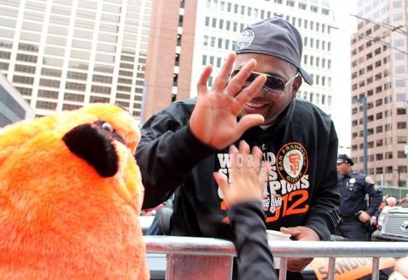 Pablo Sandoval high fives a fan wearing a panda hat. Photo by Chelsi Moy.
