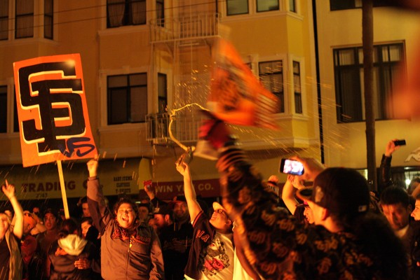 Giants fans take to the streets after the Giants beat the Detroit Tigers to win the World Series on Sunday. Photo by Rigoberto Hernandez