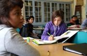 Dinorah Salazar's sixth-grade class work on math problems before beginning the lesson.