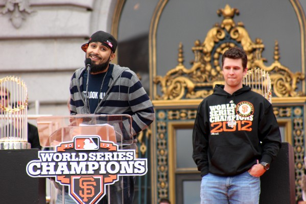 Giants pitcher Sergio Romo talks to fans in front of City Hall as Giants catcher Buster Posey looks on. Photo by Rigoberto Hernandez.
