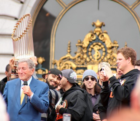 """Tony Bennett sings I Left My Heart in San Francisco to the crowd as Giants pitcher Sergio Romo """"Romo bombs"""" the picture. Photo by Rigoberto Hernandez."""