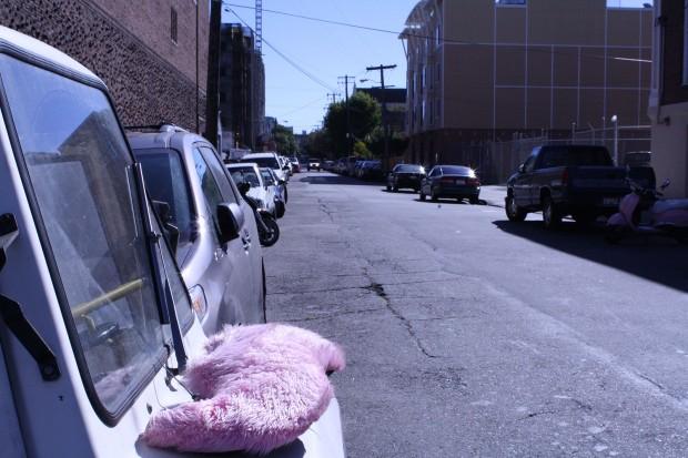 Pink mustache on parking enforcement vehicle.