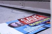 "Supervisor Campos' flyer under a ""Save City College, Mandelman for College Board"" flyer on the sidewalk."