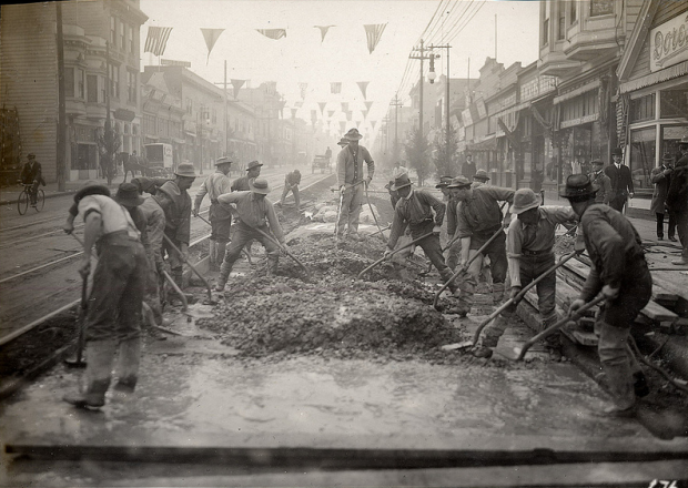 Workers paving and surfacing the road on Mission Street at 18th, December 9, 1910. Photo by the San Francisco Public Library Historical Photos.