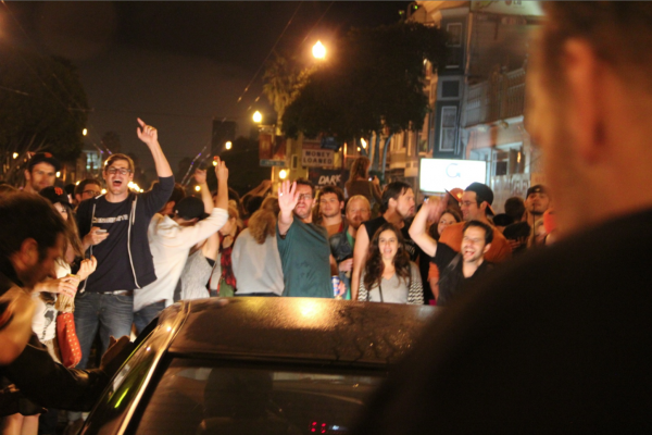 Cars found the crowds difficult to navigate on Mission St. Photo by Mateo Hoke